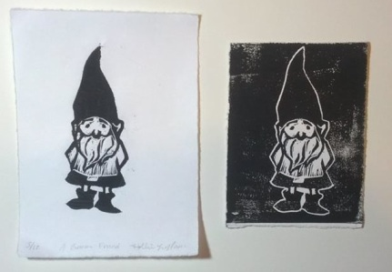 A baby gnome about 2x4 inches. Printmaking.